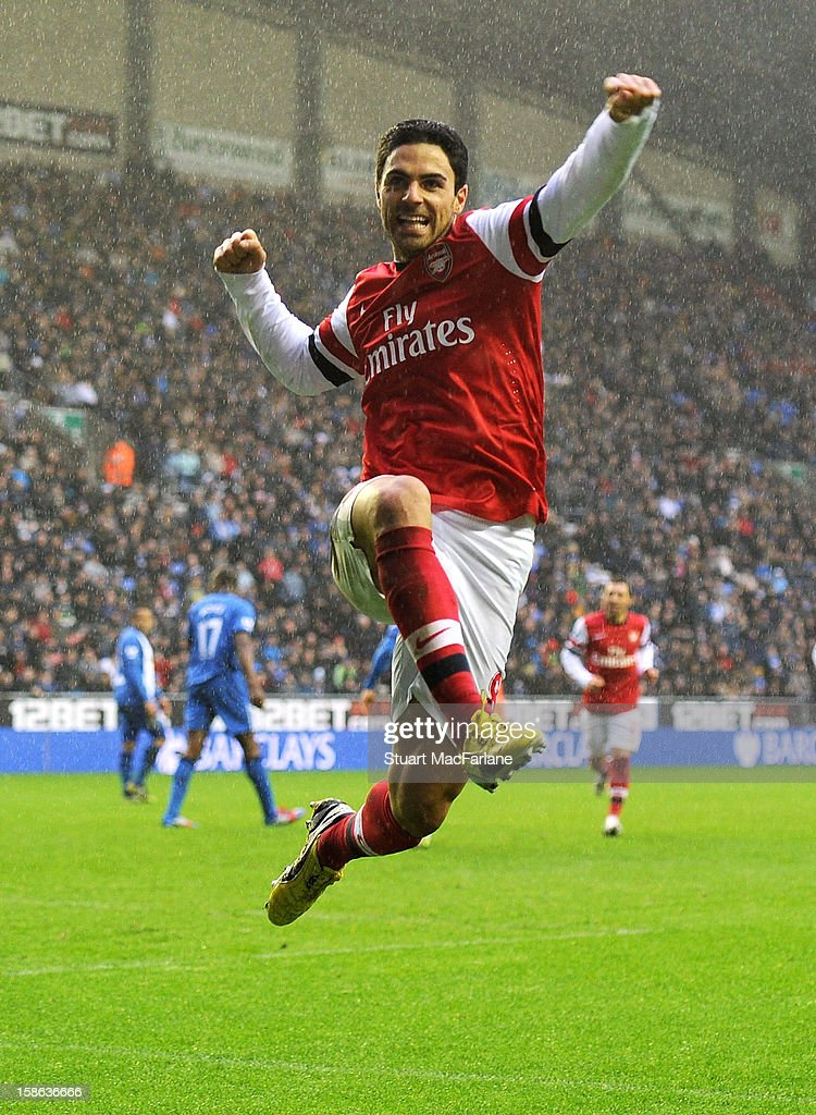 <a gi-track='captionPersonalityLinkClicked' href=/galleries/search?phrase=Mikel+Arteta&family=editorial&specificpeople=235322 ng-click='$event.stopPropagation()'>Mikel Arteta</a> celebrates scoring the Arsenal goal during the Barclays Premier League match between Wigan Athletic and Arsenal at DW Stadium on December 22, 2012 in Wigan, England.