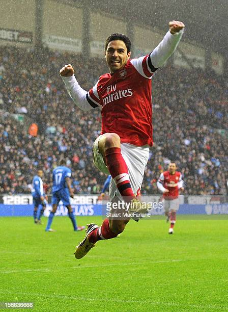 Mikel Arteta celebrates scoring the Arsenal goal during the Barclays Premier League match between Wigan Athletic and Arsenal at DW Stadium on...