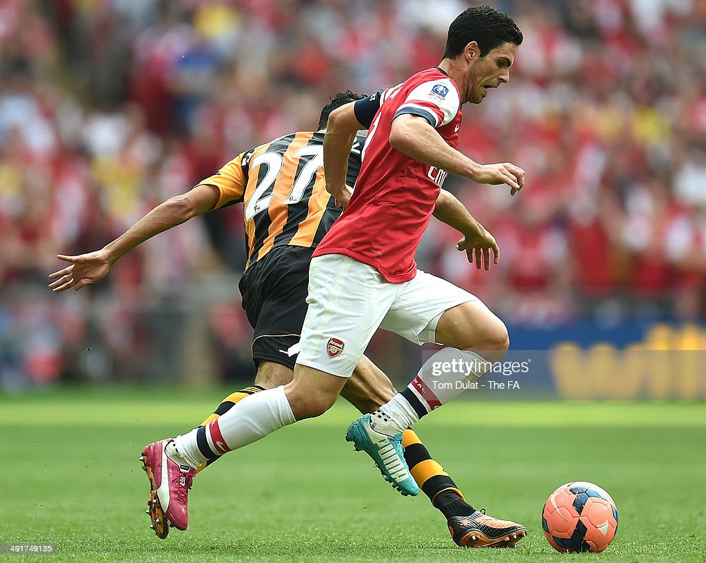 Mikel Arteta of Arsenal and Ahmed Elmohamdy of Hull City battle for the ball during the FA Cup with Budweiser Final match between Arsenal and Hull City at Wembley Stadium on May 17, 2014 in London, England.