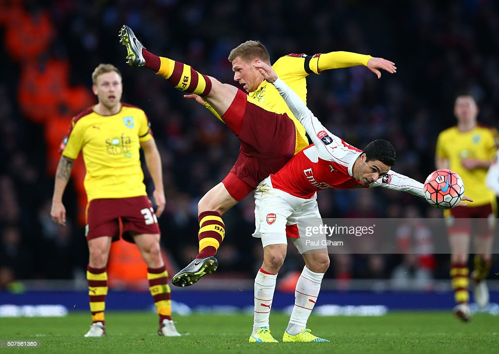 Mikel Arteta of Arsenal and Rouwen Hennings of Burnley compete for the ball during the Emirates FA Cup Fourth Round match between Arsenal and Burnley at Emirates Stadium on January 30, 2016 in London, England.