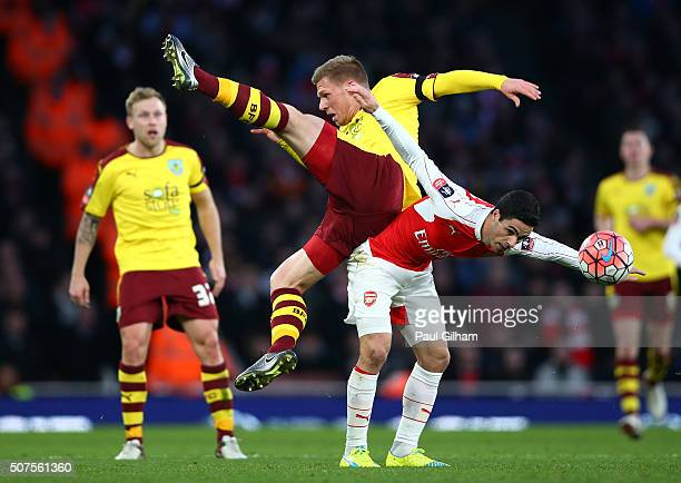 Mikel Arteta of Arsenal and Rouwen Hennings of Burnley compete for the ball during the Emirates FA Cup Fourth Round match between Arsenal and Burnley...