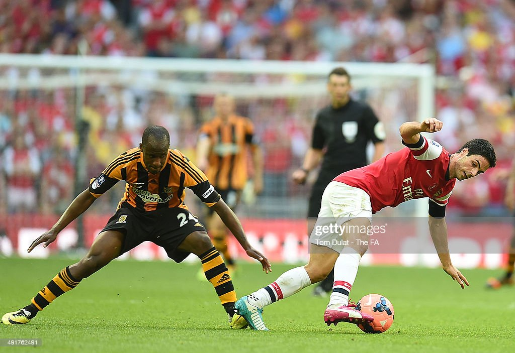 Mikel Arteta of Arsenal and Sone Aluko of Hull City battle forthe ball during the FA Cup with Budweiser Final match between Arsenal and Hull City at Wembley Stadium on May 17, 2014 in London, England.