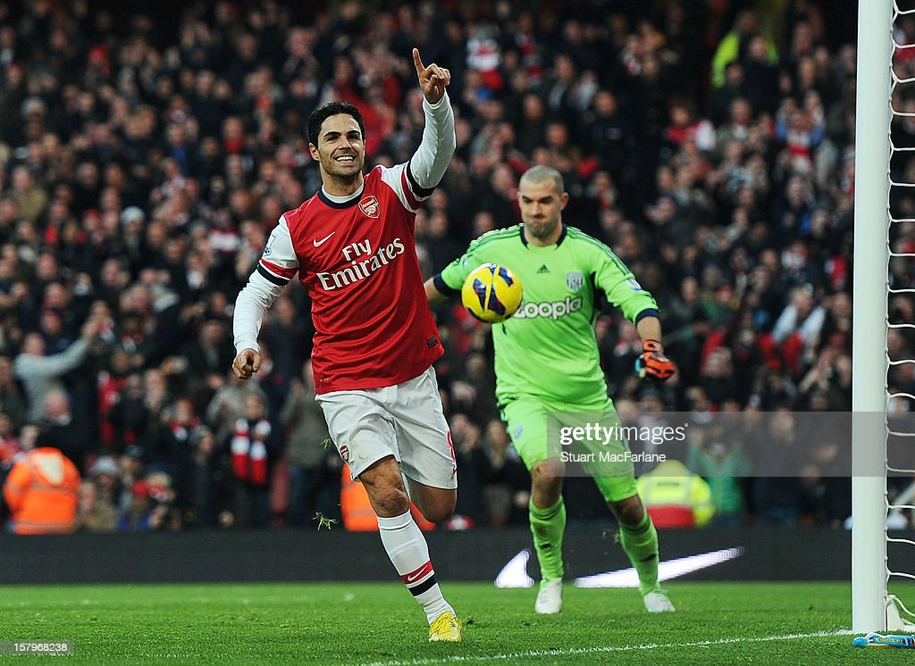 <a gi-track='captionPersonalityLinkClicked' href=/galleries/search?phrase=Mikel+Arteta&family=editorial&specificpeople=235322 ng-click='$event.stopPropagation()'>Mikel Arteta</a> of Arsenal celebrates scoring a penalty during the Barclays Premier League match between Arsenal and West Bromwich Albion, at Emirates Stadium on December 08, 2012 in London, England.