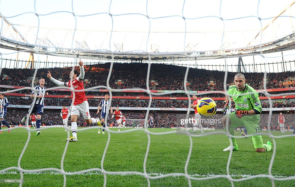 <a gi-track='captionPersonalityLinkClicked' href=/galleries/search?phrase=Mikel+Arteta&family=editorial&specificpeople=235322 ng-click='$event.stopPropagation()'>Mikel Arteta</a> of Arsenal celebrates scoring the 1st goal from the penalty spot during the Barclays Premier League match between Arsenal and West Bromwich Albion, at Emirates Stadium on December 08, 2012 in London, England.
