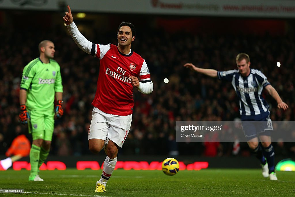 <a gi-track='captionPersonalityLinkClicked' href=/galleries/search?phrase=Mikel+Arteta&family=editorial&specificpeople=235322 ng-click='$event.stopPropagation()'>Mikel Arteta</a> of Arsenal celebrates scoring their second goal from the penalty spot during the Barclays Premier League match between Arsenal and West Bromwich Albion at Emirates Stadium on December 8, 2012 in London, England.