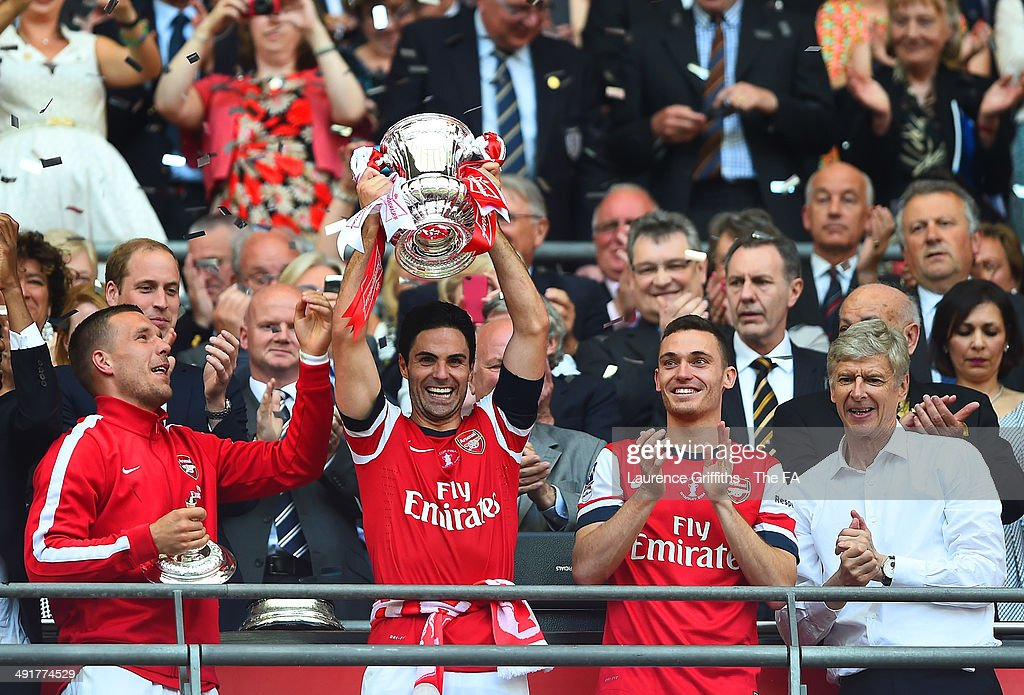 Mikel Arteta of Arsenal celebrates with his teammates as he lifts the FA Cup after the FA Cup with Budweiser Final match between Arsenal and Hull...