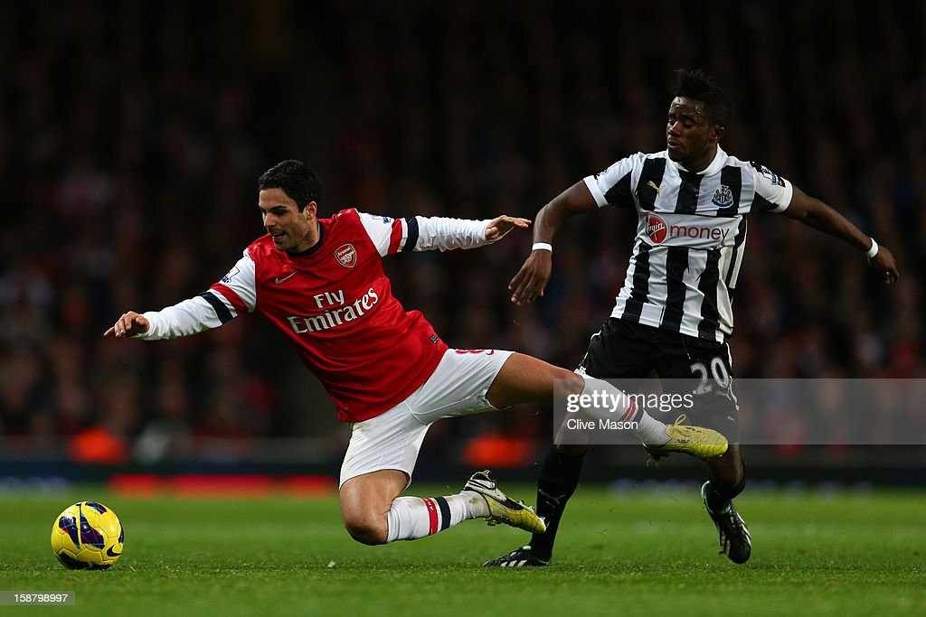 <a gi-track='captionPersonalityLinkClicked' href=/galleries/search?phrase=Mikel+Arteta&family=editorial&specificpeople=235322 ng-click='$event.stopPropagation()'>Mikel Arteta</a> of Arsenal clashes with Gael Bigirimana of Newcastle United during the Barclays Premier League match between Arsenal and Newcastle United at the Emirates Stadium on December 29, 2012 in London, England.