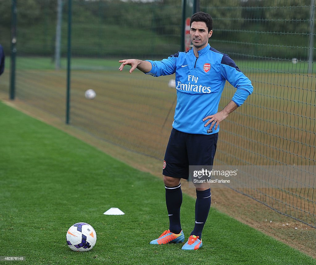 <a gi-track='captionPersonalityLinkClicked' href=/galleries/search?phrase=Mikel+Arteta&family=editorial&specificpeople=235322 ng-click='$event.stopPropagation()'>Mikel Arteta</a> of Arsenal during a training session at London Colney on April 5, 2014 in St Albans, England.