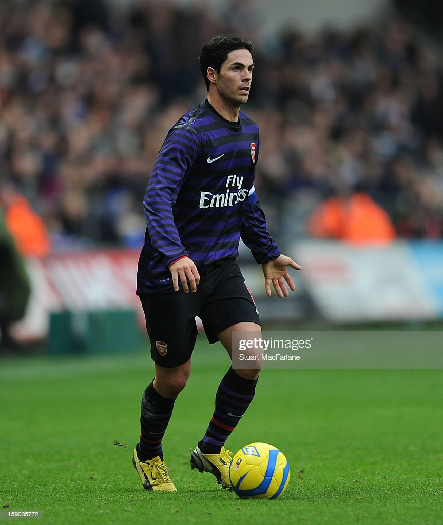<a gi-track='captionPersonalityLinkClicked' href=/galleries/search?phrase=Mikel+Arteta&family=editorial&specificpeople=235322 ng-click='$event.stopPropagation()'>Mikel Arteta</a> of Arsenal during the FA Cup Third Round match between Swansea City and Arsenal at the Liberty Stadium on January 6, 2013 in Swansea, Wales.
