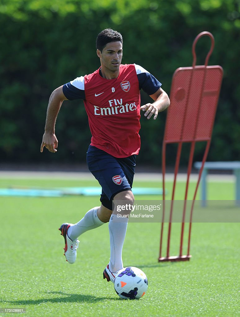 <a gi-track='captionPersonalityLinkClicked' href=/galleries/search?phrase=Mikel+Arteta&family=editorial&specificpeople=235322 ng-click='$event.stopPropagation()'>Mikel Arteta</a> of Arsenal in action during a training session at London Colney on July 08, 2013 in St Albans, England.