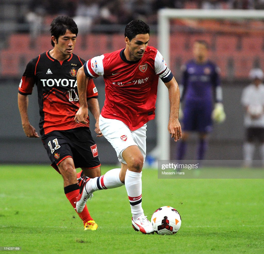 <a gi-track='captionPersonalityLinkClicked' href=/galleries/search?phrase=Mikel+Arteta&family=editorial&specificpeople=235322 ng-click='$event.stopPropagation()'>Mikel Arteta</a> #8 of Arsenal in action during the pre-season friendly match between Nagoya Grampus and Arsenal at Toyota Stadium on July 22, 2013 in Toyota, Aichi, Japan.