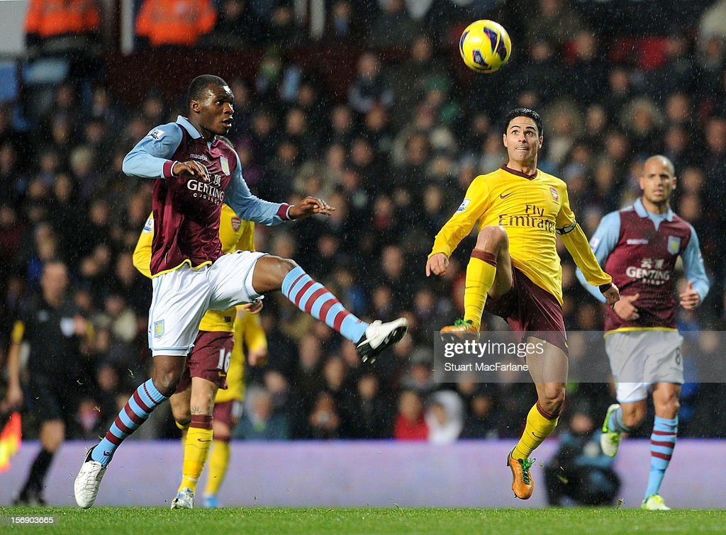 <a gi-track='captionPersonalityLinkClicked' href=/galleries/search?phrase=Mikel+Arteta&family=editorial&specificpeople=235322 ng-click='$event.stopPropagation()'>Mikel Arteta</a> of Arsenal is challenged by <a gi-track='captionPersonalityLinkClicked' href=/galleries/search?phrase=Christian+Benteke&family=editorial&specificpeople=4282509 ng-click='$event.stopPropagation()'>Christian Benteke</a> of Aston Villa during the Barclays Premier League match between Aston Villa and Arsenal at Villa Park on November 24, 2012 in Birmingham, England.