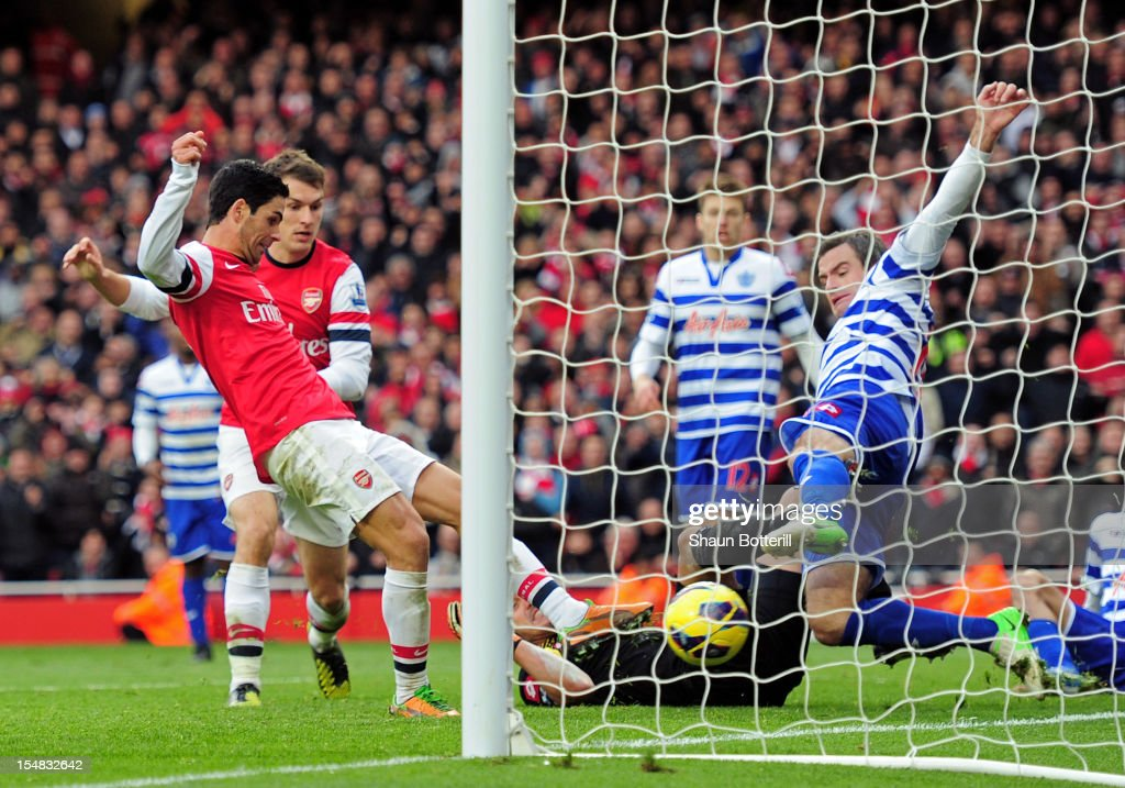 <a gi-track='captionPersonalityLinkClicked' href=/galleries/search?phrase=Mikel+Arteta&family=editorial&specificpeople=235322 ng-click='$event.stopPropagation()'>Mikel Arteta</a> of Arsenal pokes the ball past <a gi-track='captionPersonalityLinkClicked' href=/galleries/search?phrase=Ryan+Nelsen&family=editorial&specificpeople=220929 ng-click='$event.stopPropagation()'>Ryan Nelsen</a> of QPR to score the opening goal during the Barclays Premier League match between Arsenal and QPR at The Emirates Stadium on October 27, 2012 in London, England.