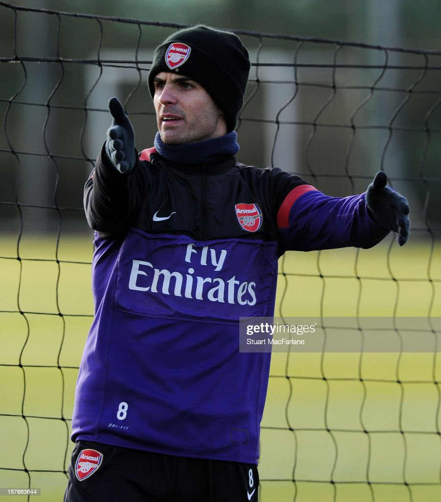 <a gi-track='captionPersonalityLinkClicked' href=/galleries/search?phrase=Mikel+Arteta&family=editorial&specificpeople=235322 ng-click='$event.stopPropagation()'>Mikel Arteta</a> of Arsenal reacts during a training session at London Colney on December 07, 2012 in St Albans, England.