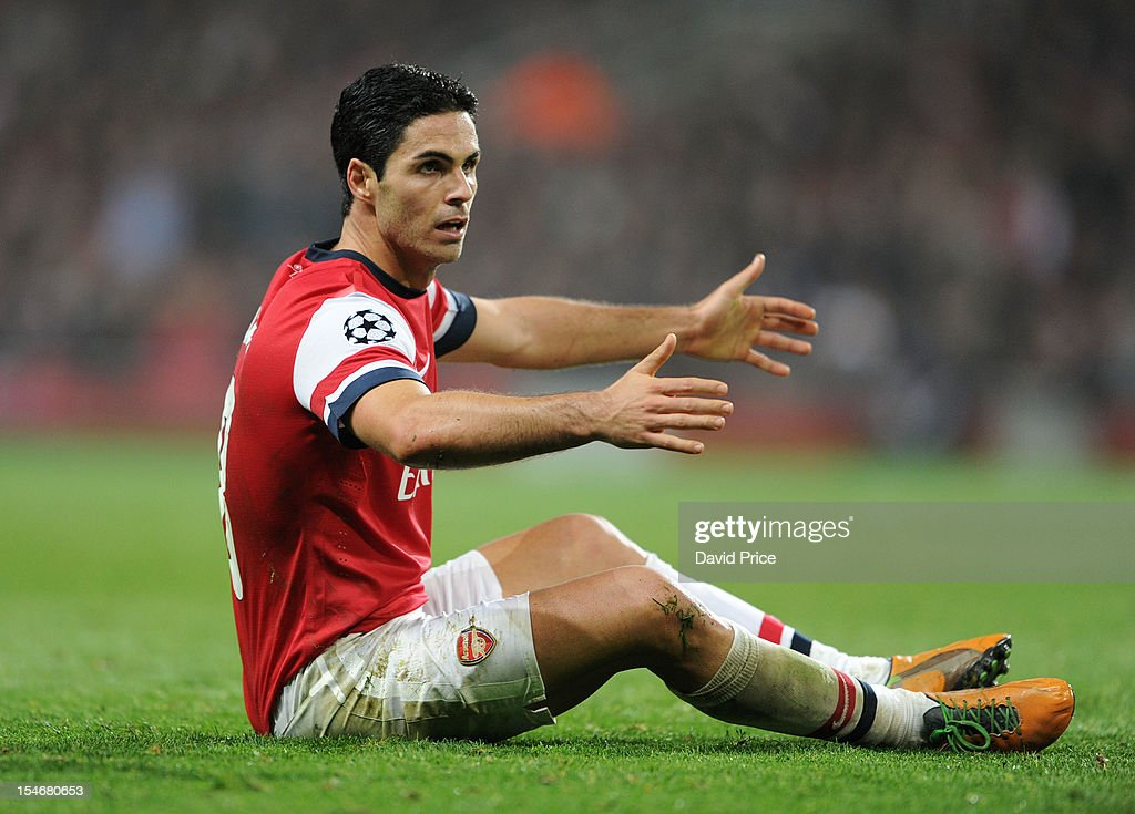 <a gi-track='captionPersonalityLinkClicked' href=/galleries/search?phrase=Mikel+Arteta&family=editorial&specificpeople=235322 ng-click='$event.stopPropagation()'>Mikel Arteta</a> of Arsenal reacts during the UEFA Champions League Group B match between Arsenal FC and FC Schalke 04 at Emirates Stadium on October 24, 2012 in London, England.
