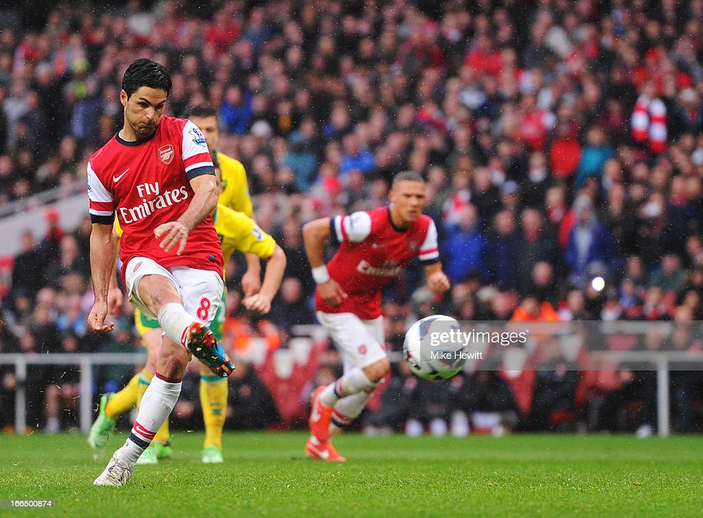 <a gi-track='captionPersonalityLinkClicked' href=/galleries/search?phrase=Mikel+Arteta&family=editorial&specificpeople=235322 ng-click='$event.stopPropagation()'>Mikel Arteta</a> of Arsenal scores a goal during a free kick at the Barclays Premier League match between Arsenal and Norwich City at Emirates Stadium on April 13, 2013 in London, England.