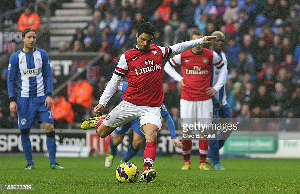 Mikel Arteta of Arsenal scores the opening goal from the penalty spot during the Barclays Premier League match between Wigan Athletic and Arsenal at...