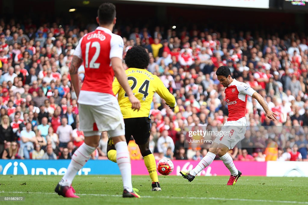 Mikel Arteta of Arsenal shoots at goal resulting in their team's fourth goal scored own goal by Mark Bunn of Aston Villa during the Barclays Premier League match between Arsenal and Aston Villa at Emirates Stadium on May 15, 2016 in London, England.