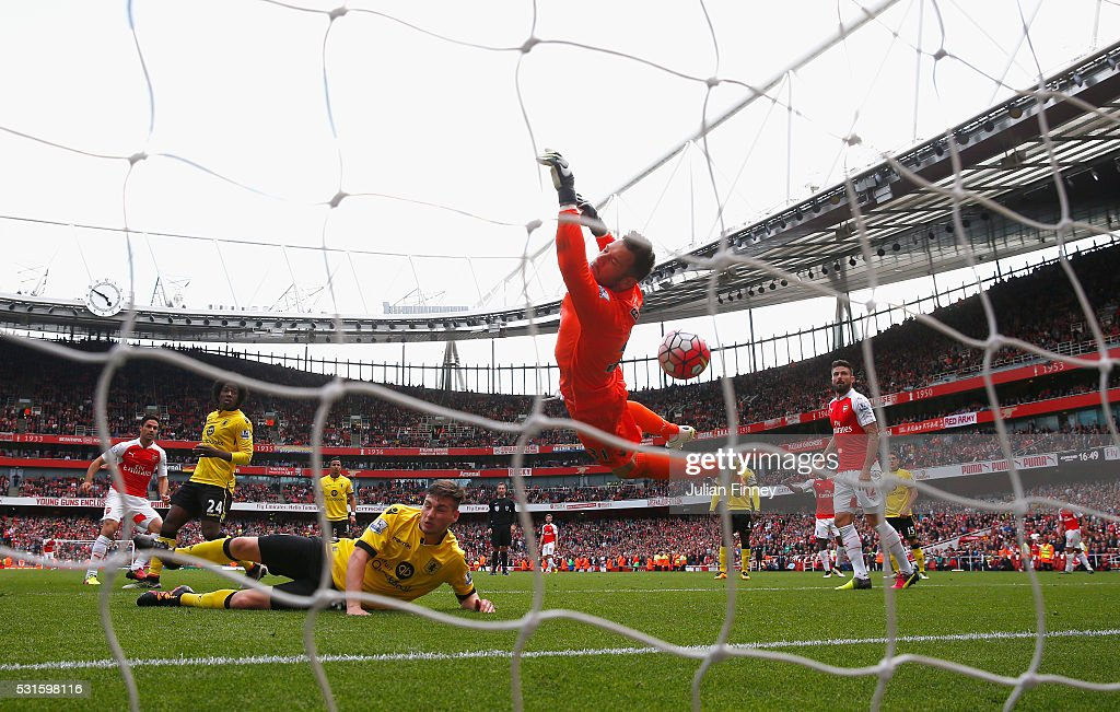 Mikel Arteta of Arsenal shot hits the cross bar which rebounds off Mark Bunn of Aston Villa for their fourth goal during the Barclays Premier League match between Arsenal and Aston Villa at the Emirates Stadium on May 15, 2016 in London, England.
