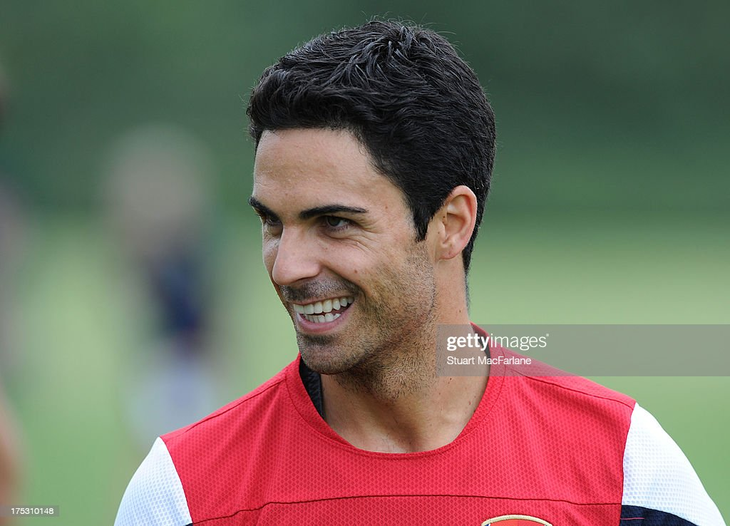 <a gi-track='captionPersonalityLinkClicked' href=/galleries/search?phrase=Mikel+Arteta&family=editorial&specificpeople=235322 ng-click='$event.stopPropagation()'>Mikel Arteta</a> of Arsenal smiles during a training session at London Colney on August 02, 2013 in St Albans, England.