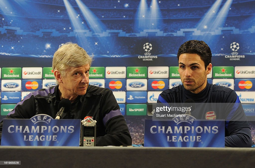 Mikel Arteta (R) of Arsenal speaks beside manager Arsene Wenger during a press conference ahead of their UEFA Champions League match against FC Bayern Muenchen at London Colney on February 18, 2013 in St Albans, England.