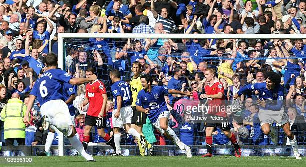 Mikel Arteta of Everton celebrates scoring their third goal during the Barclays Premier League match between Everton and Manchester United at...