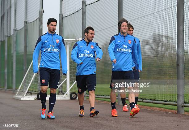 Mikel Arteta Santi Cazorla and Tomas Rosicky of Arsenal before a training session at London Colney on March 28 2014 in St Albans England
