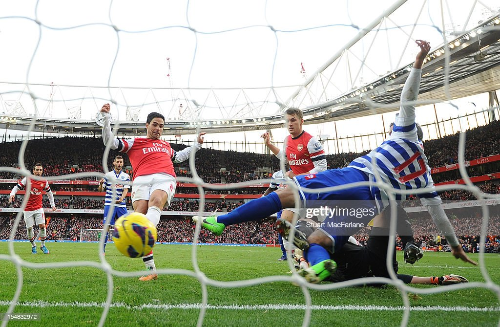 <a gi-track='captionPersonalityLinkClicked' href=/galleries/search?phrase=Mikel+Arteta&family=editorial&specificpeople=235322 ng-click='$event.stopPropagation()'>Mikel Arteta</a> (L) shoots the ball past QPR defender Ryan Nelson (R) to score the only goal of the game during the Barclays Premier League match between Arsenal and Queens Park Rangers, at Emirates Stadium on October 27, 2012 in London, England.