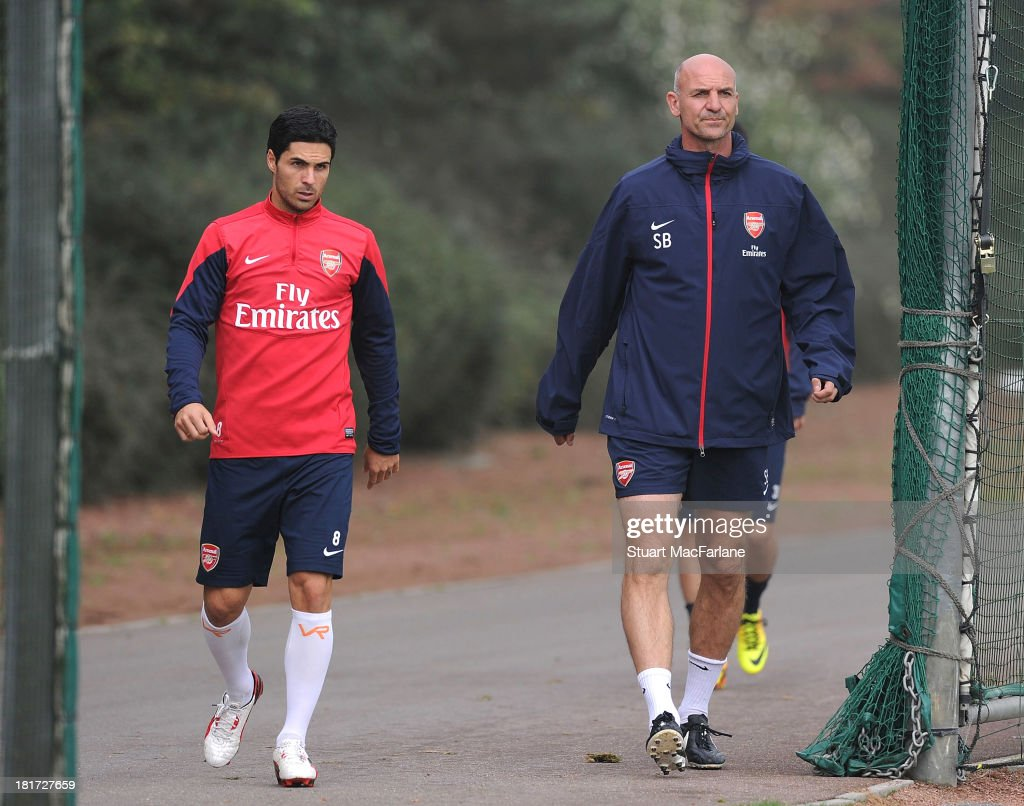 Mikel Arteta with Arsenal assistant manager Steve Bould before a training session at London Colney on September 24, 2013 in St Albans, England.