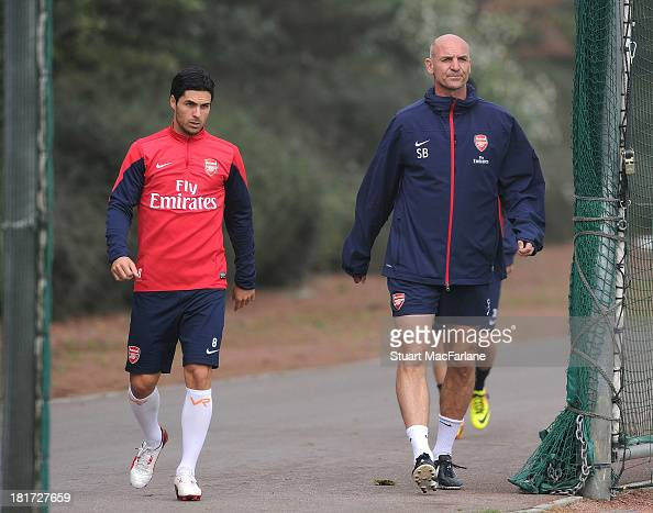 Mikel Arteta with Arsenal assistant manager Steve Bould before a training session at London Colney on September 24 2013 in St Albans England