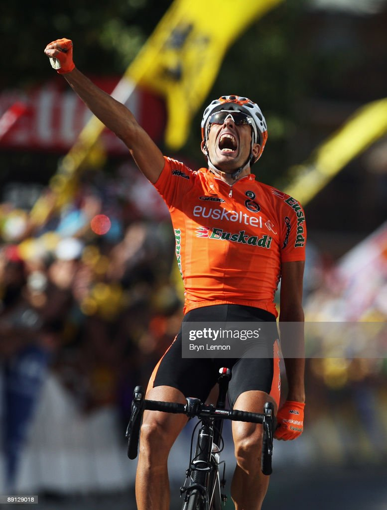 JULY 21 Mikel Astarloza of Spain and EuskaltelEuskadi celebrates as he crosses the finish line to win stage 16 of the 2009 Tour de France from...