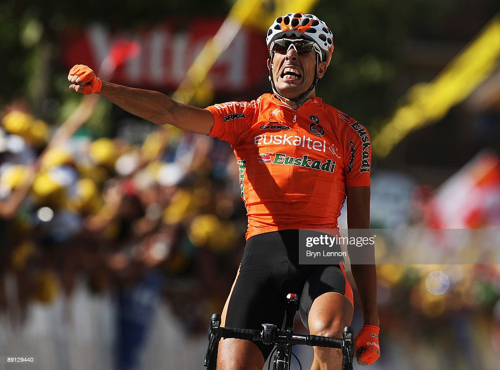Mikel Astarloza of Spain and EuskaltelEuskadi celebrates as he crosses the finish line to win stage 16 of the 2009 Tour de France from Martigny to...