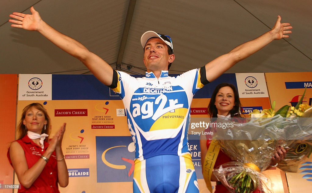 Mikel Astarloza of Spain salutes the crowd on the podium after winning the Tour Down Under held in Adelaide Australia on January 26 2003