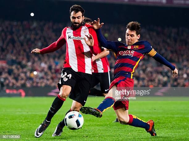 Mikel Balenziaga of Athletic Club and Lionel Messi of FC Barcelona fight for the ball during the Copa del Rey Quarter Final Second Leg between FC...