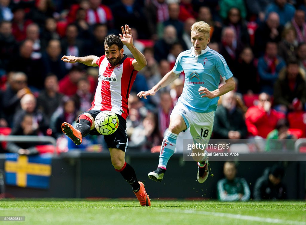 Mikel Balenziaga of Athletic Club Bilbao competes for the ball with <a gi-track='captionPersonalityLinkClicked' href=/galleries/search?phrase=Daniel+Wass&family=editorial&specificpeople=7487616 ng-click='$event.stopPropagation()'>Daniel Wass</a> of RC Celta de Vigo during the La Liga match between Athletic Club Bilbao and RC Celta de Vigo at San Mames Stadium on May 01, 2016 in Bilbao, .