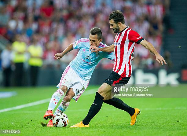 Mikel Balenziaga of Athletic Club duels for the ball with Fabian Orellana of Celta de Vigo during the La Liga match between Athletic Club and Celta...