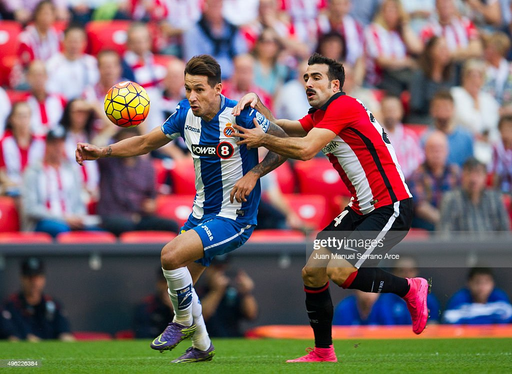 Mikel Balenziaga of Athletic Club duels for the ball with Hernan Perez of RCD Espanyol during the La Liga match between Athletic Club and RCD...