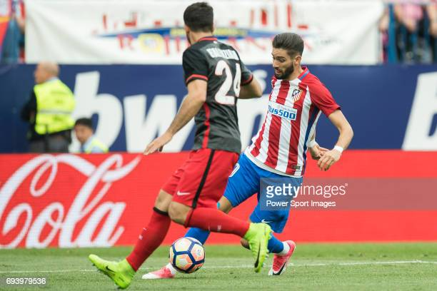 Mikel Balenziaga Oruesagasti of Athletic Club fights for the ball with Yannick Ferreira Carrasco of Atletico de Madrid during the La Liga match...