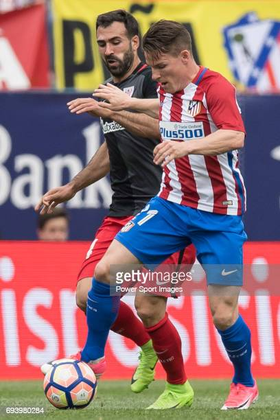 Mikel Balenziaga Oruesagasti of Athletic Club fights for the ball with Kevin Gameiro of Atletico de Madrid during the La Liga match between Atletico...