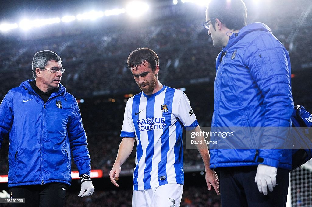 Mikel Gonzalez Martinez of Real Sociedad leaves the pitch injured during the Copa del Rey SemiFinal first leg match between Barcelona and Real...