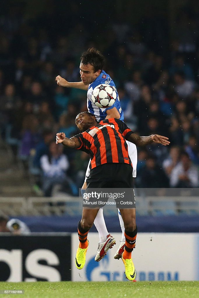 Mikel Gonzalez of Real Sociedad duels for the ball with Luiz Adriano of FC Shakhtar Donetsk during the UEFA Champions league football match between...