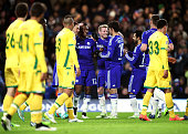 Mikel John Obi of Chelsea is congratulated by teammates after scoring his team's third goal during the UEFA Champions League group G match between...
