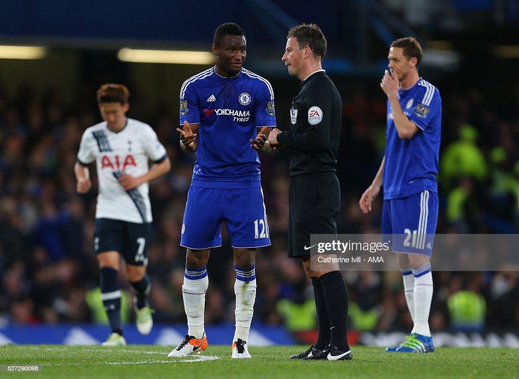 Mikel John Obi of Chelsea talks to referee Mark Clattenburg during the Barclays Premier League match between Chelsea and Tottenham Hotspur at Stamford Bridge on May 2, 2016 in London, England.