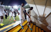 Mikel John Obi of Nigeria and Godfrey Oboabona return to the dressing room after the FIFA Confederations Cup Brazil 2013 Group B match between Tahiti...