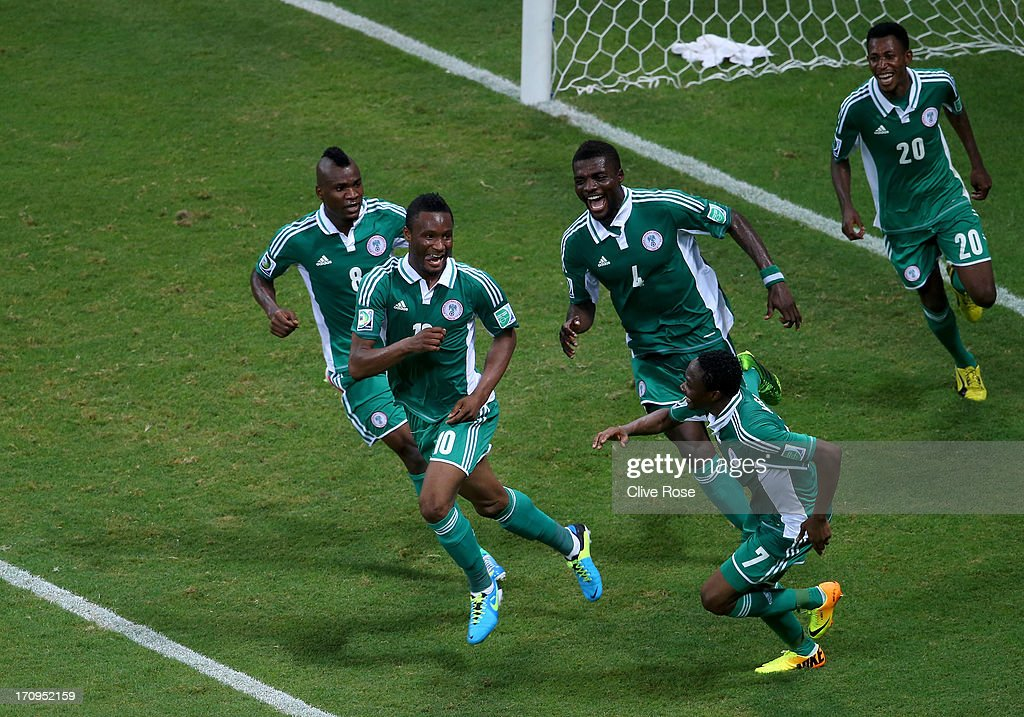 <a gi-track='captionPersonalityLinkClicked' href=/galleries/search?phrase=Mikel+John+Obi&family=editorial&specificpeople=4050358 ng-click='$event.stopPropagation()'>Mikel John Obi</a> of Nigeria celebrates with his team-mates after scoring his team's first goal during the FIFA Confederations Cup Brazil 2013 Group B match between Nigeria and Uruguay at Estadio Octavio Mangabeira (Arena Fonte Nova Salvador) on June 20, 2013 in Salvador, Brazil.