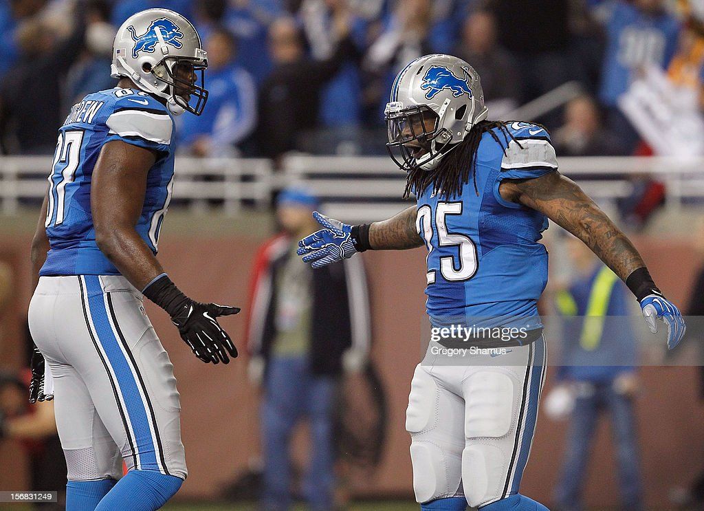 Mikel Leshoure #25 of the Detroit Lions celebrates a first quarter touchdown with Brandon Pettigrew #87 while playing the Houston Texans at Ford Field on November 22, 2012 in Detroit, Michigan.