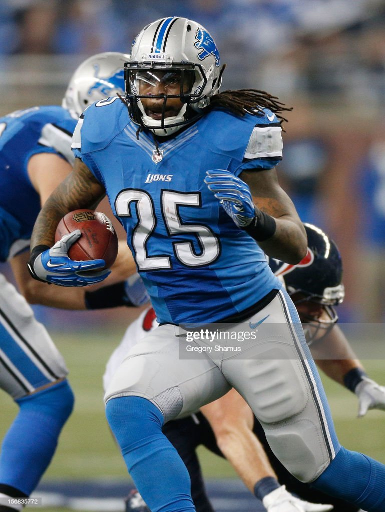 Mikel Leshoure #25 of the Detroit Lions looks for open running room while playing the Houston Texans at Ford Field on November 22, 2012 in Detroit, Michigan. Houston won the game 34-31. Photo by Gregory Shamus/Getty Images)
