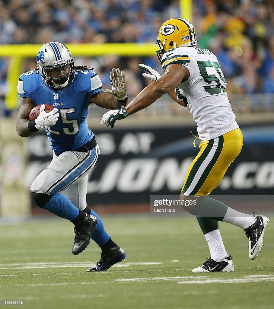 Mikel Leshoure #25 of the Detroit Lions runs for a first down as Brad Jones #59 of the Green Bay Packers gets ready to make the stop during the game at Ford Field on November 18, 2012 in Detroit, Michigan. The Packers defeated the Lions 24-20.