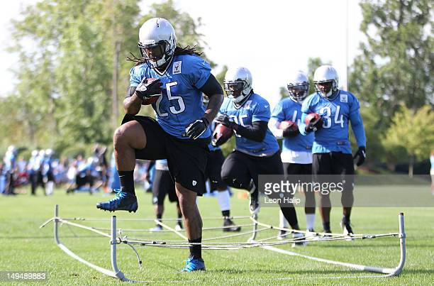 Mikel Leshoure of the Detroit Lions runs through the running drills during the morning practice session on July 28 2012 in Allen Park Michigan