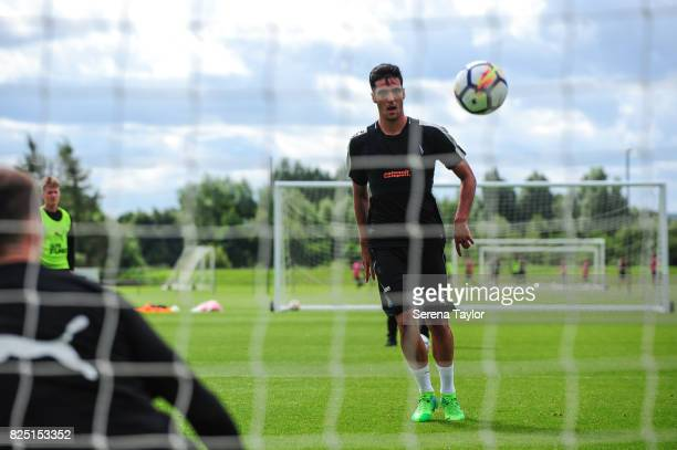 Mikel Merino heads the ball during the Newcastle United Training session at the Newcastle United Training ground on August 1 in Newcastle upon Tyne...